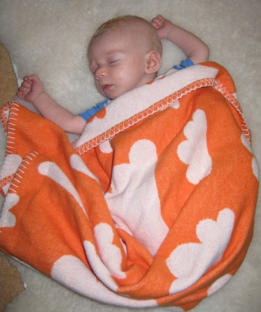 When Stina was just a couple of months fast asleep under her blanket