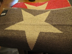 Pappelina plastic doormats with a large star